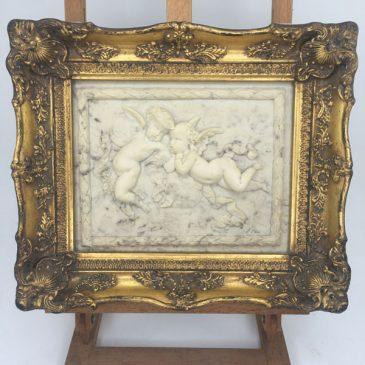 faux marble relief cherubs gilt frame
