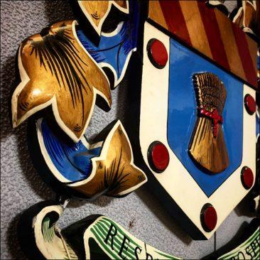 heavy cast metal coat of arms