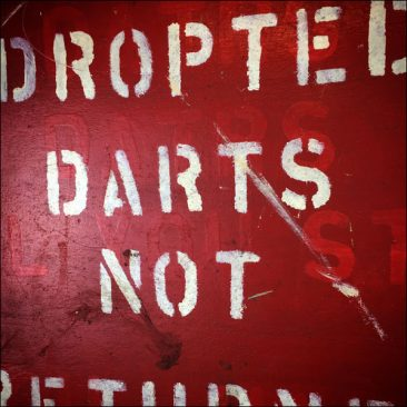 vintage sign from a fairground darts game