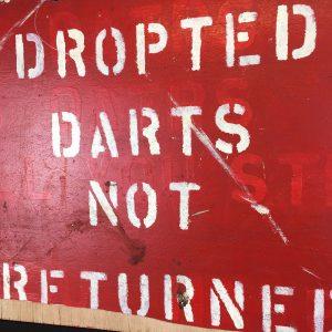fairground darts game sign